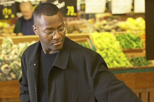 Image of African American male shopping in the grocery store